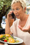 Woman is calling during a break in the restaurant Stock Image