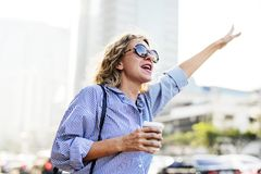 Woman calling for a cab Royalty Free Stock Photo
