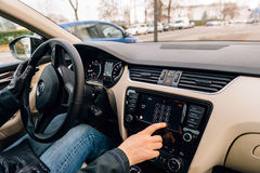 Woman calling from Car Play Apple Car dashboard Royalty Free Stock Images