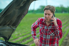 Woman calling car repair service from counrty road Royalty Free Stock Photography
