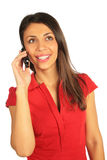 Woman calling on cell phone. Woman in red dress calling on a cell phone Stock Photos