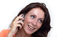 Woman calling with cellphone Royalty Free Stock Images