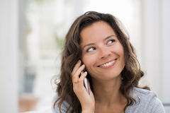 Woman calling with cellphone indoor Royalty Free Stock Photo