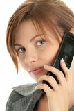 Woman calling by cellular phone. Attractive young woman calling by cellular phone isolated on white background Royalty Free Stock Photography