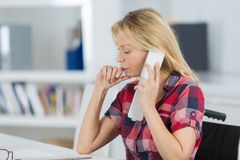 Woman calling on cellular phone Royalty Free Stock Photography