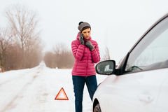 Woman calling for help or assistance - winter car breakdown Stock Photography