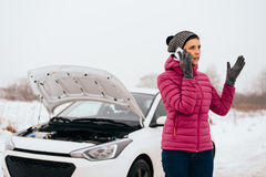 Woman calling for help or assistance - winter car breakdown Royalty Free Stock Photos