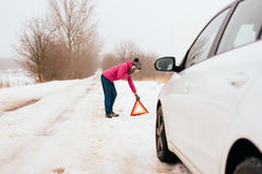 Woman calling for help or assistance - winter car breakdown Royalty Free Stock Images