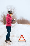 Woman calling for help or assistance - winter car breakdown Royalty Free Stock Image