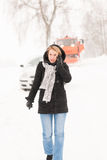 Woman calling for help broken car snow Stock Photos