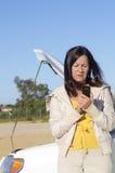 Woman calling help car breakdown Stock Photography
