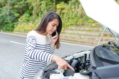Woman calling for help with car broken in the roadside Royalty Free Stock Images
