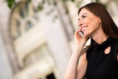 Woman calling on her phone Royalty Free Stock Image