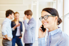 Woman calling with her phone Stock Images