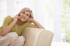 Woman calling at home Stock Photography