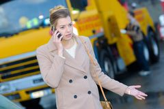 Woman calling insurence because car problem. Woman calling insurence because of car problem Stock Image