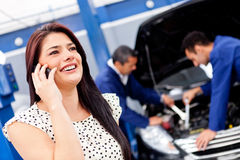 Woman calling mechanic Royalty Free Stock Images
