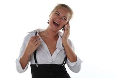 Woman calling by mobile phone Royalty Free Stock Image