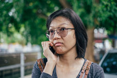 Woman calling with mobile phone disappointed on somethings Stock Photos