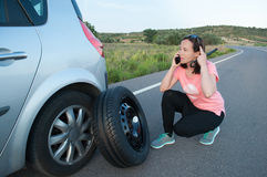 Woman calling on mobile phone roadside assistance service Stock Images