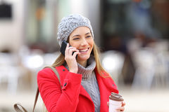 Woman calling on the mobile phone in winter Royalty Free Stock Images