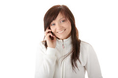 Woman is calling with a mobilephone. Young caucasian woman is calling with a mobilephone isolated Royalty Free Stock Image