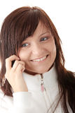 Woman is calling with a mobilephone Stock Photography