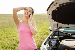 Woman Calling On Mobilephone For Road Service. Stressed Young Woman Breakdown With Car Calling For Service On Mobilephone Stock Photo
