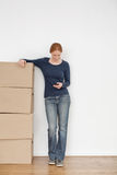 Woman Calling a Moving Company Royalty Free Stock Photos