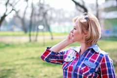 Woman calling at outdoor Royalty Free Stock Images