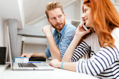 Woman calling partner from office Stock Images