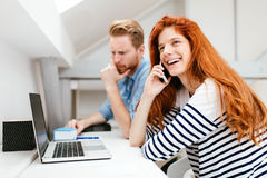 Woman calling partner from office Royalty Free Stock Images