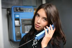 Woman calling payphone Stock Photography