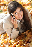 Woman calling by phone Royalty Free Stock Images
