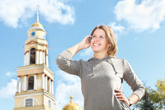 Woman calling by phone Stock Images
