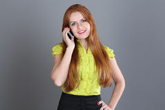 Woman calling by phone Royalty Free Stock Photography