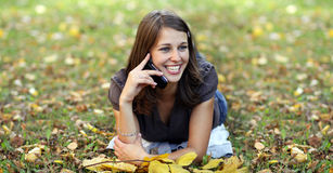 Woman calling by phone in autumn Stock Image