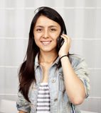 Woman calling by phone Stock Image