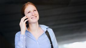 Woman Calling by Phone in a City Stock Images