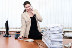 Woman calling by phone in office Royalty Free Stock Image