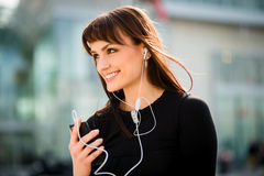 Woman calling phone in street Stock Photography