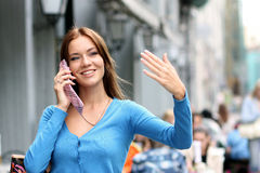 Woman calling by phone. Young woman calling by phone Royalty Free Stock Photography