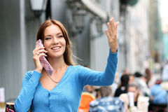Woman calling by phone. Young woman calling by phone Stock Image