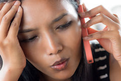 Woman calling by phone. Young woman calling by phone Royalty Free Stock Image