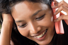 Woman calling by phone. Young happy woman calling by phone Royalty Free Stock Image