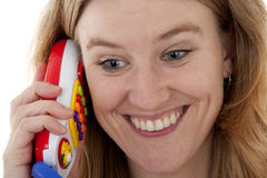 Woman is calling by play phone Royalty Free Stock Photography