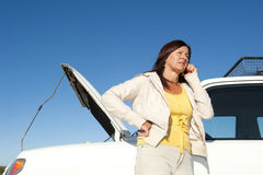 Woman calling road assistance Stock Image