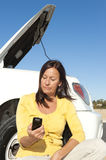 Woman calling road assistance Royalty Free Stock Photography