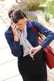 Woman calling rushing arriving home business phone. Woman calling rushing arriving home keys smart phone elegance business stock image