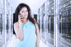 Woman calling in the server room Stock Image